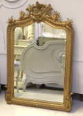 frech antique crested mirror